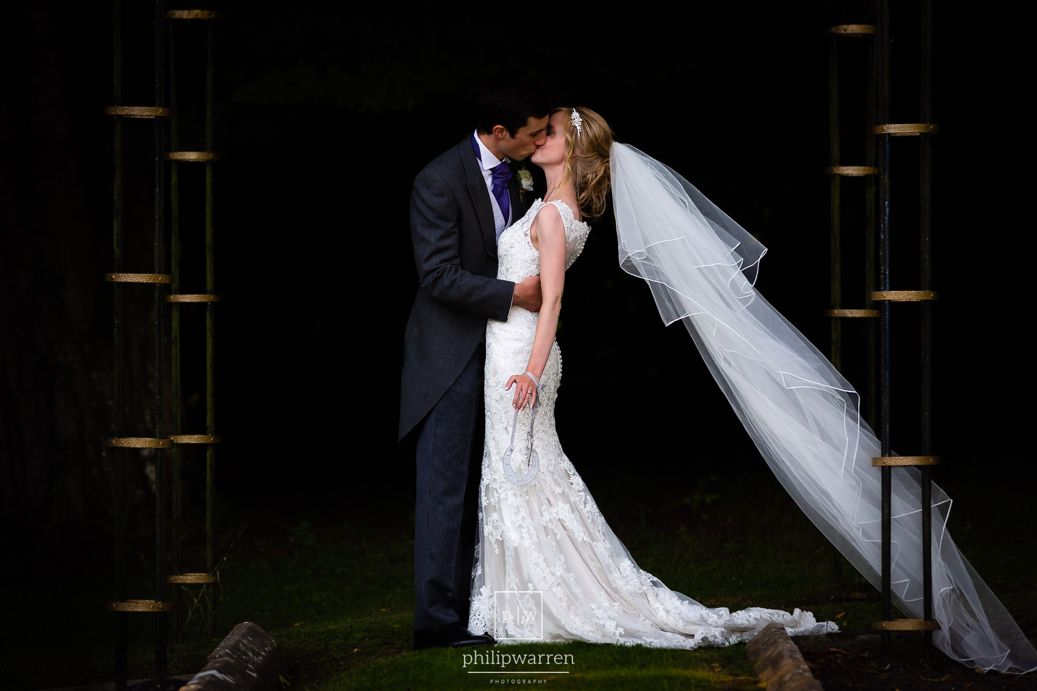 bride and groom kissing in a pagoda at court colman