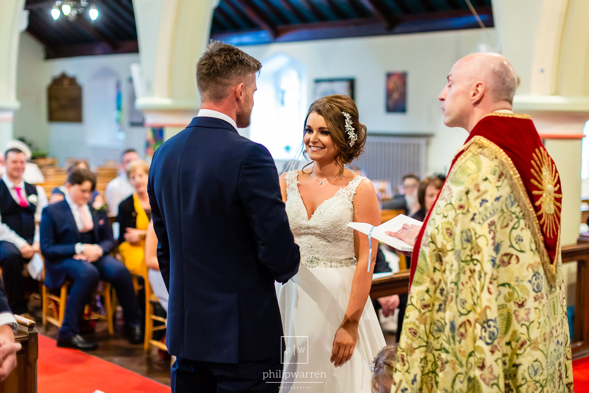 bride and groom during wedding ceremony at st fagans church