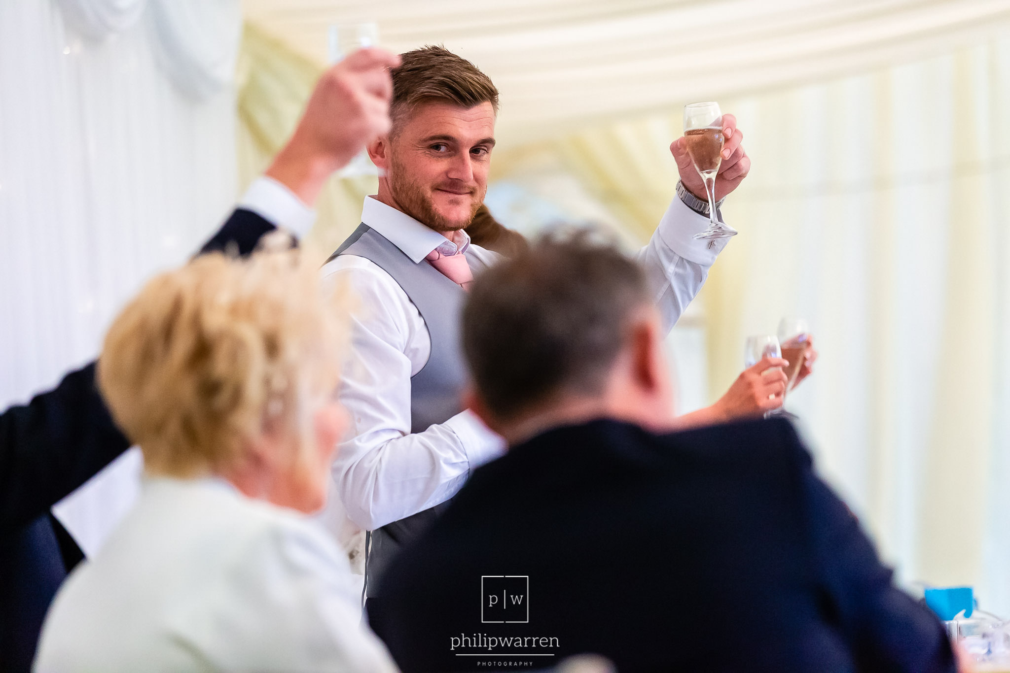 groom toastng his parents in the marquee at cottrell park