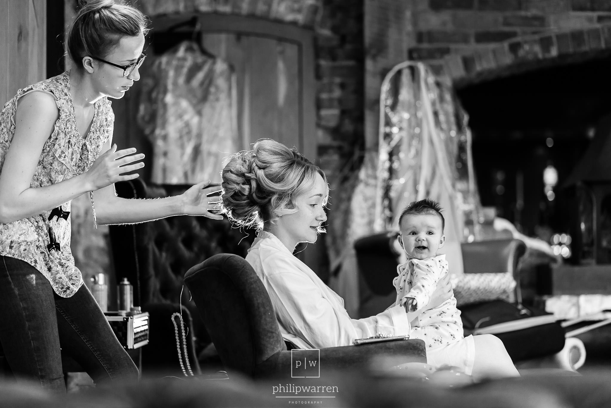 bride and her baby daughter getting ready for the wedding