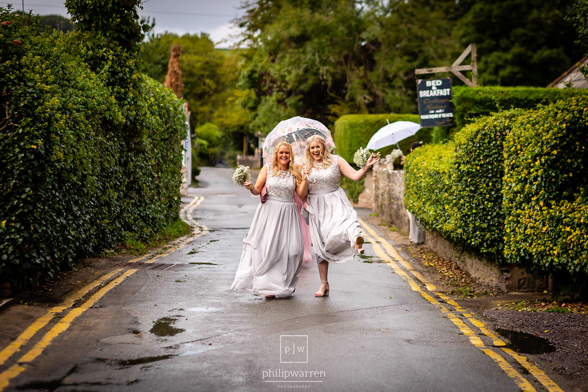 bridesmaids having fun with umbrellas