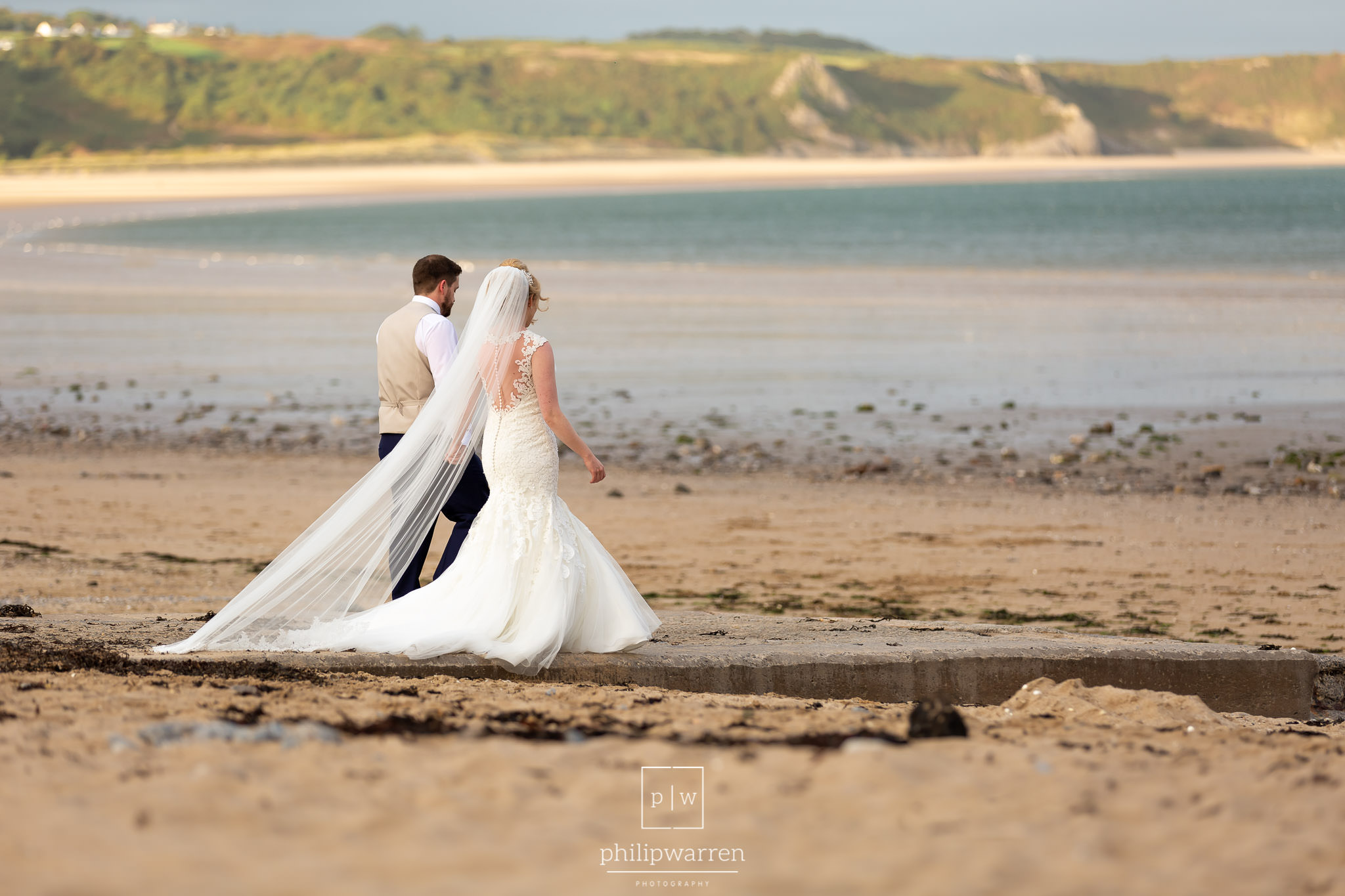 wedding photo walking down the slipway on gower beach