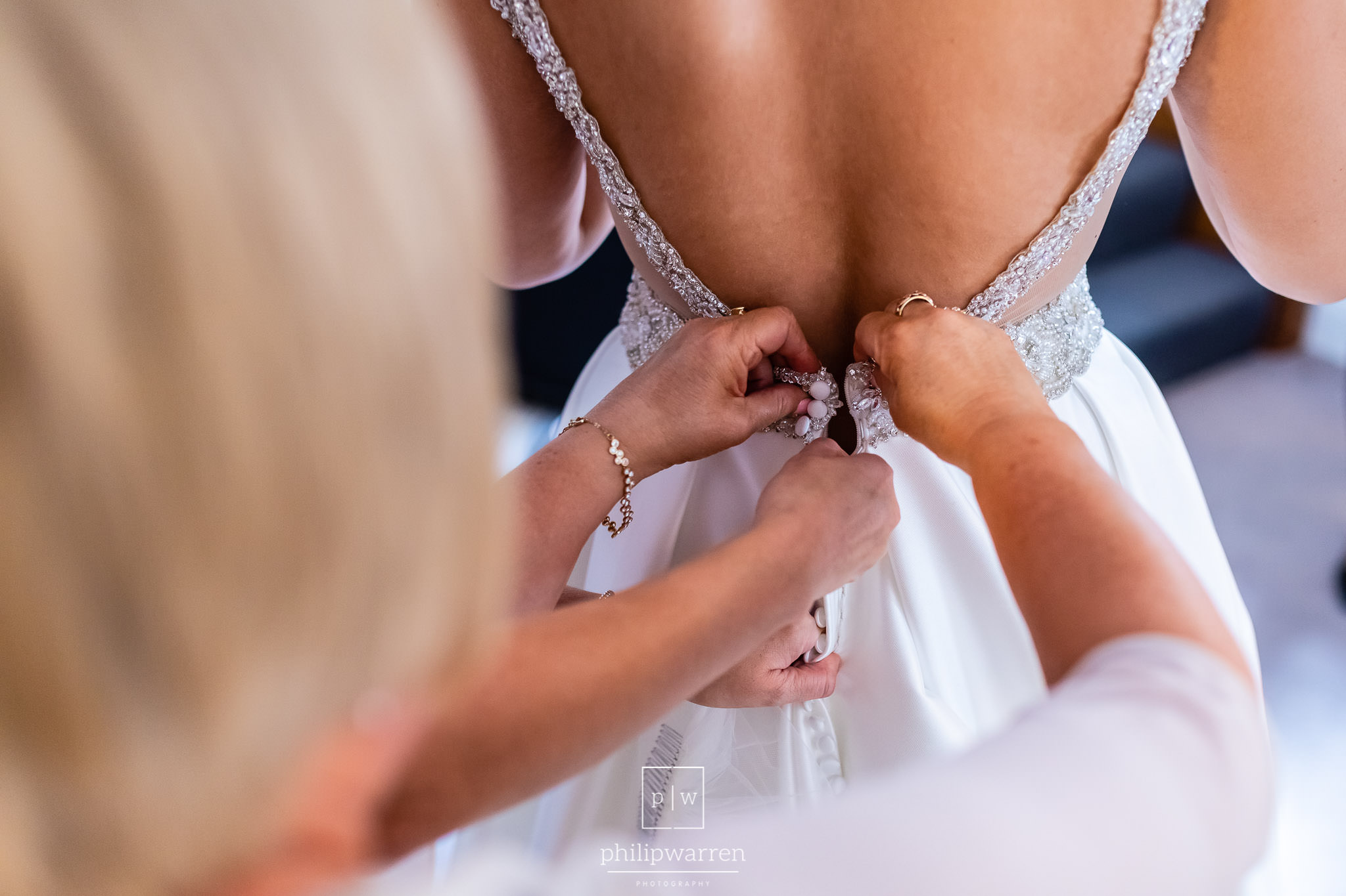 back of wedding dress being done up