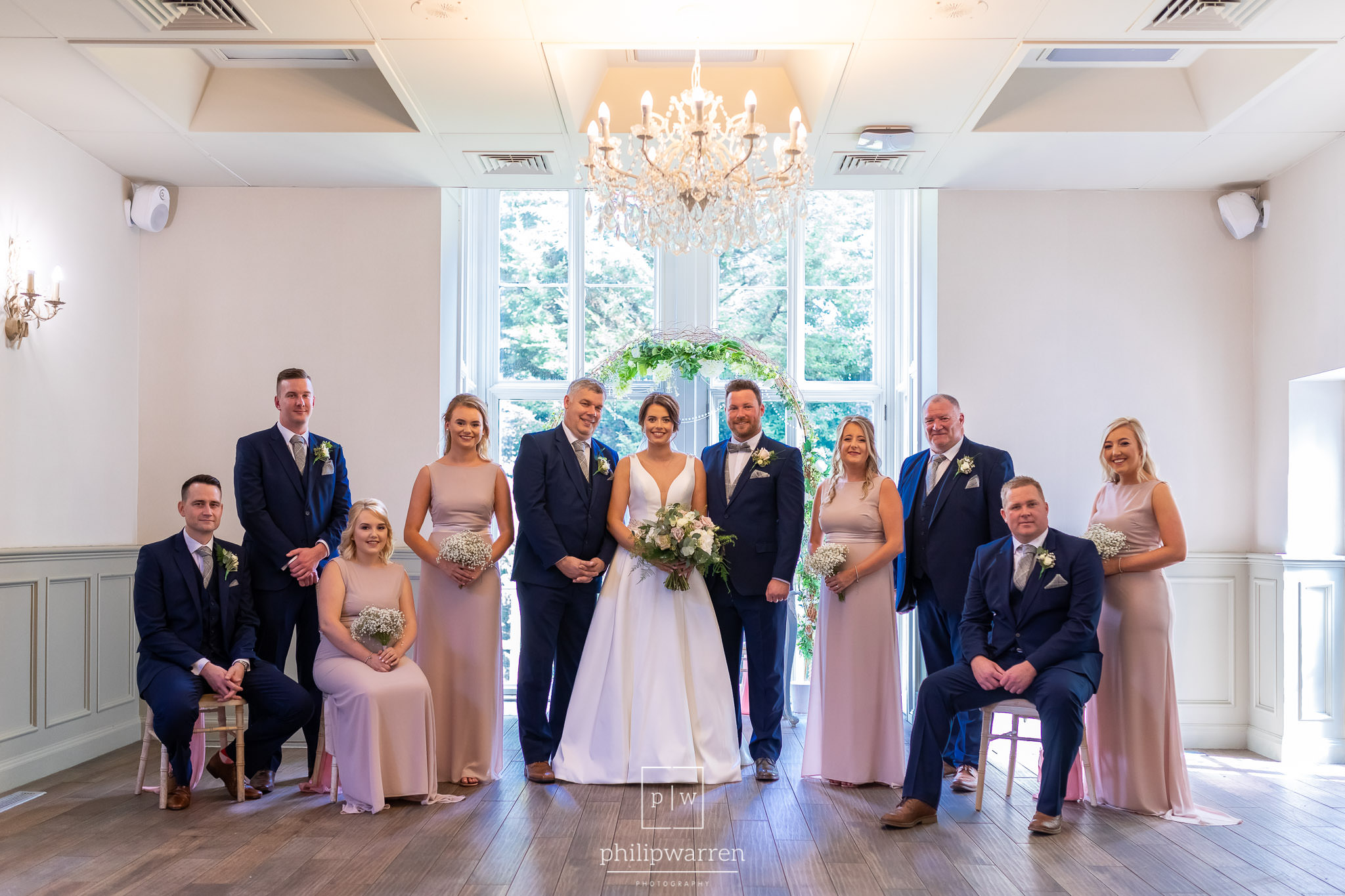 bridal party and groomsmen photo in ceremony room