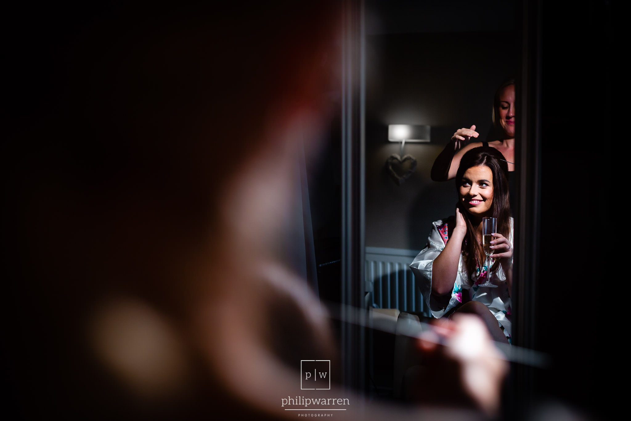 bride having hair done before the wedding