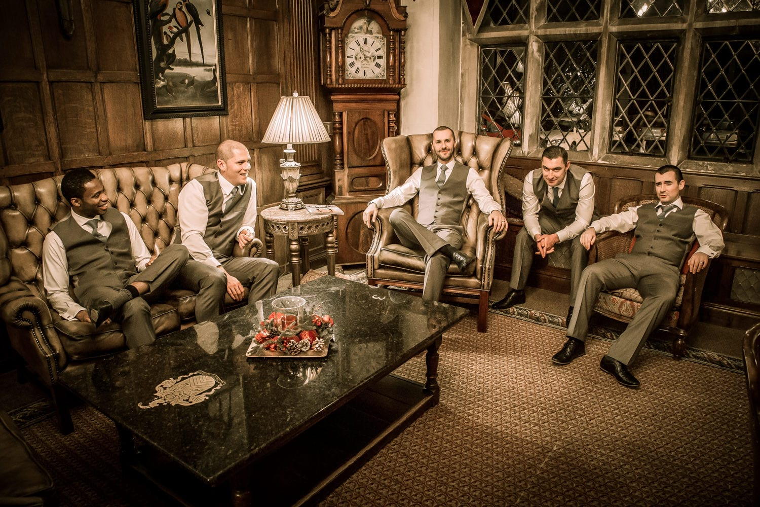 groomsmen sitting in the chairs in miskin manor