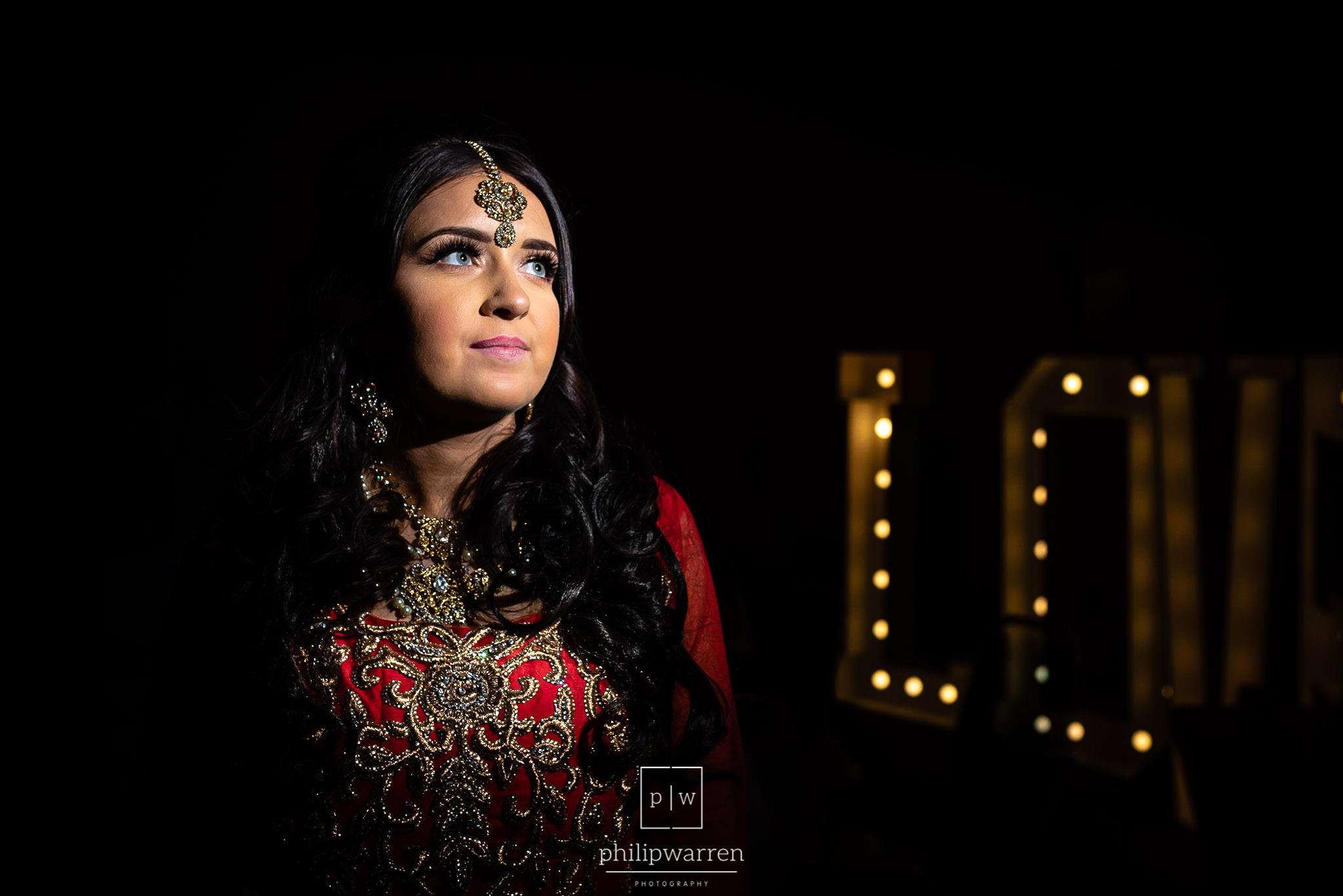 bride photo in the dark lit by flash