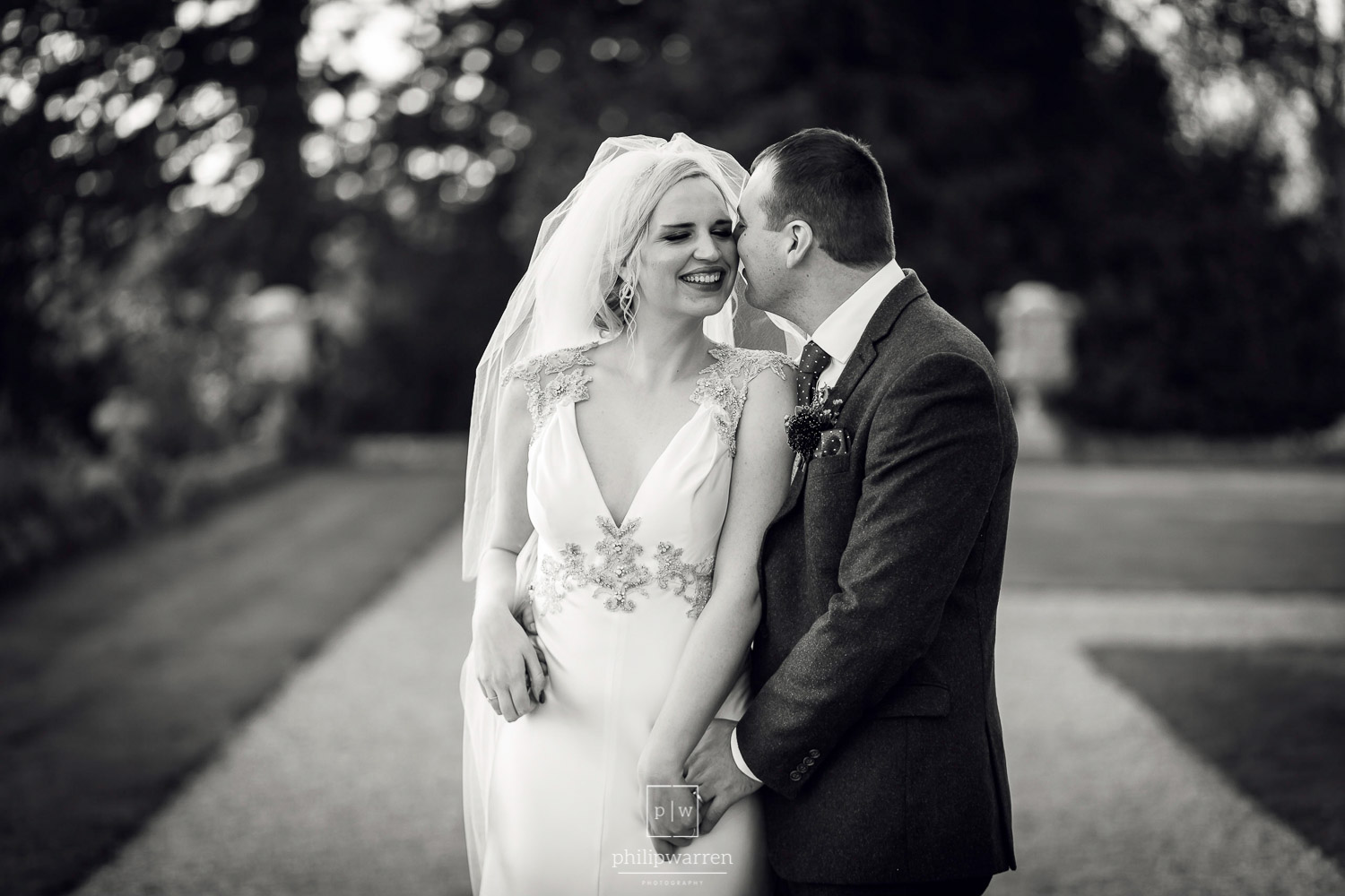 black and white photo of bride and groom at orchardleigh estate