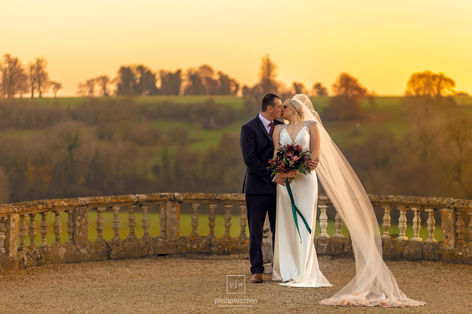 bride and groom in the sunset at orchardleigh estate