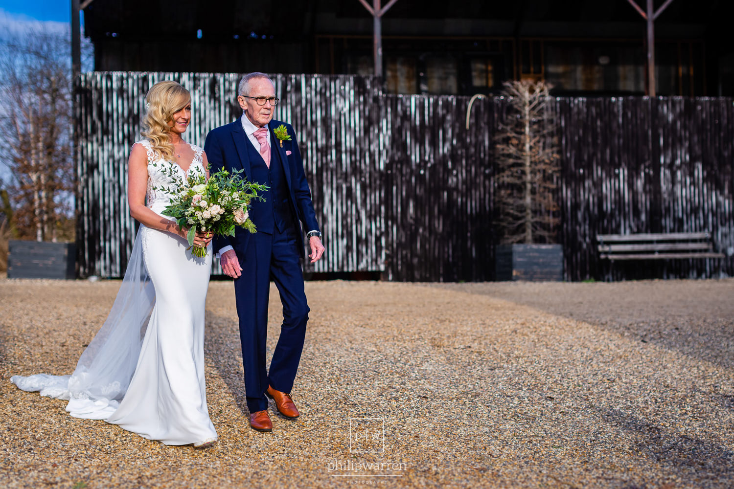 father of the bride with his daughter outside cripps barn