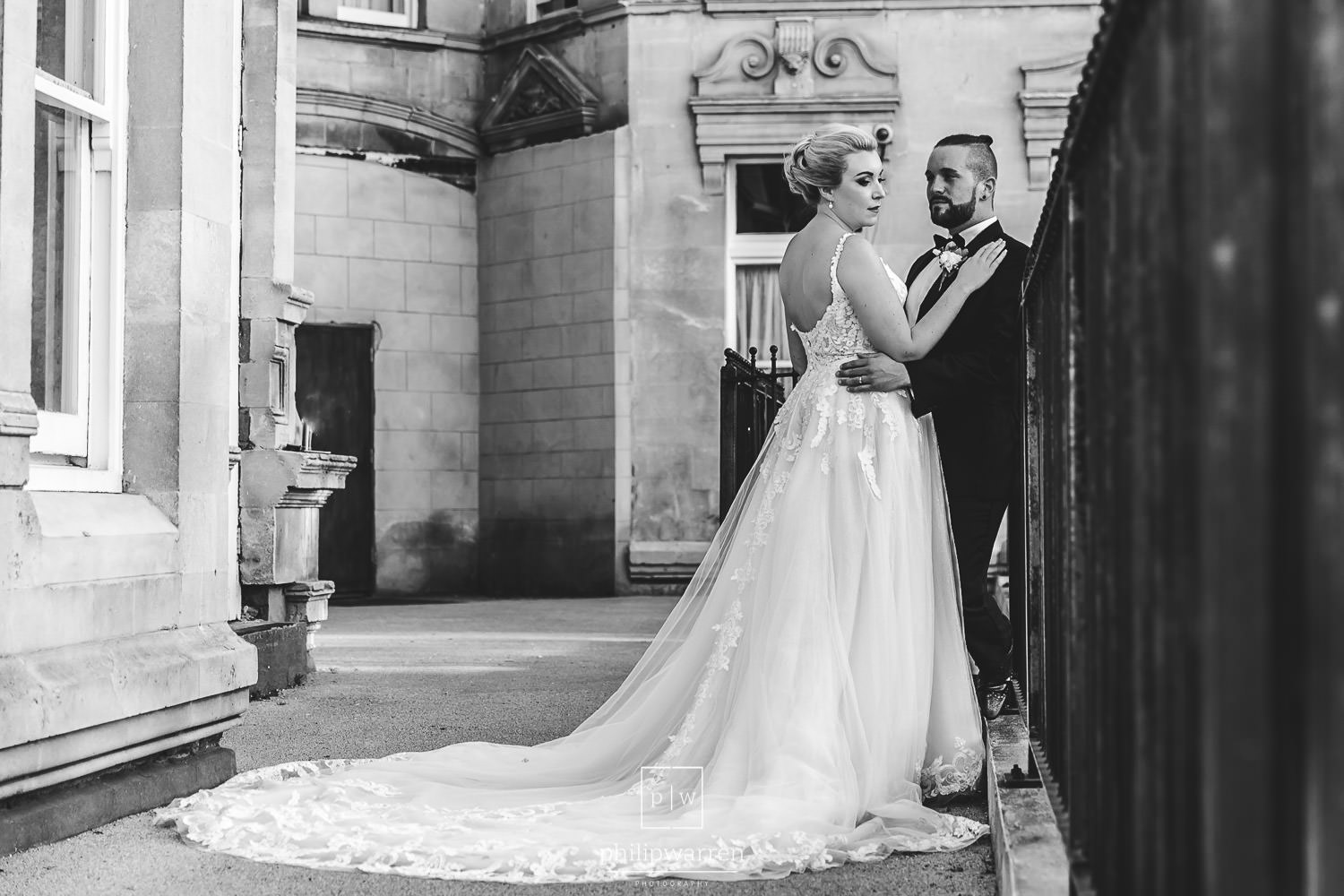 bride and groom outside of The Exchange Hotel in Cardiff
