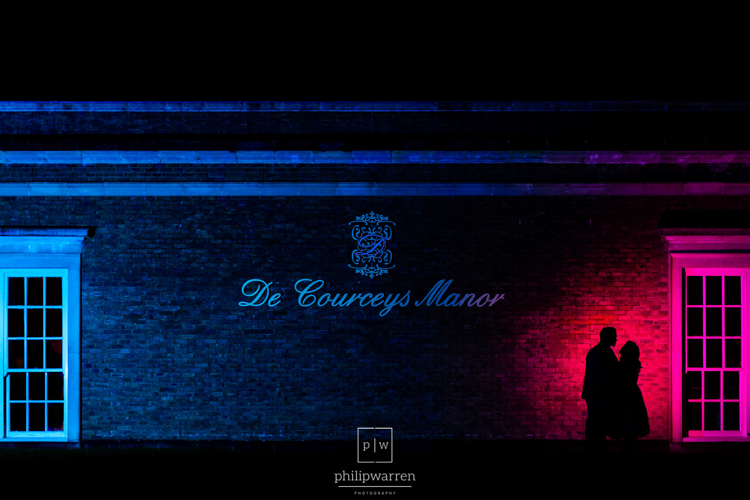 silhoute of bride and groom outside de courceys manor