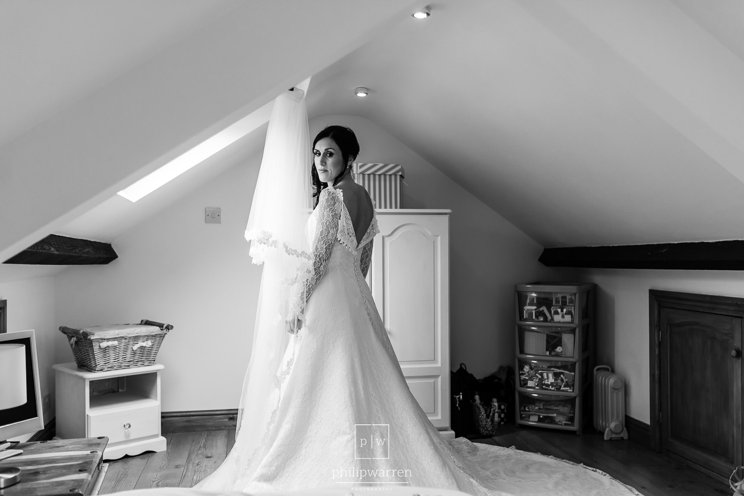 bride in her wedding dress in bedroom