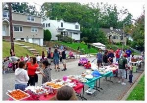 Neighbors get together at a neighborhood block party (source: KathyButler northjersey.com)