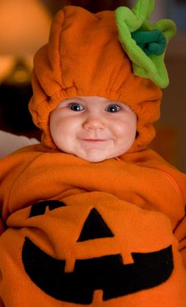 Baby in pumpkin costume