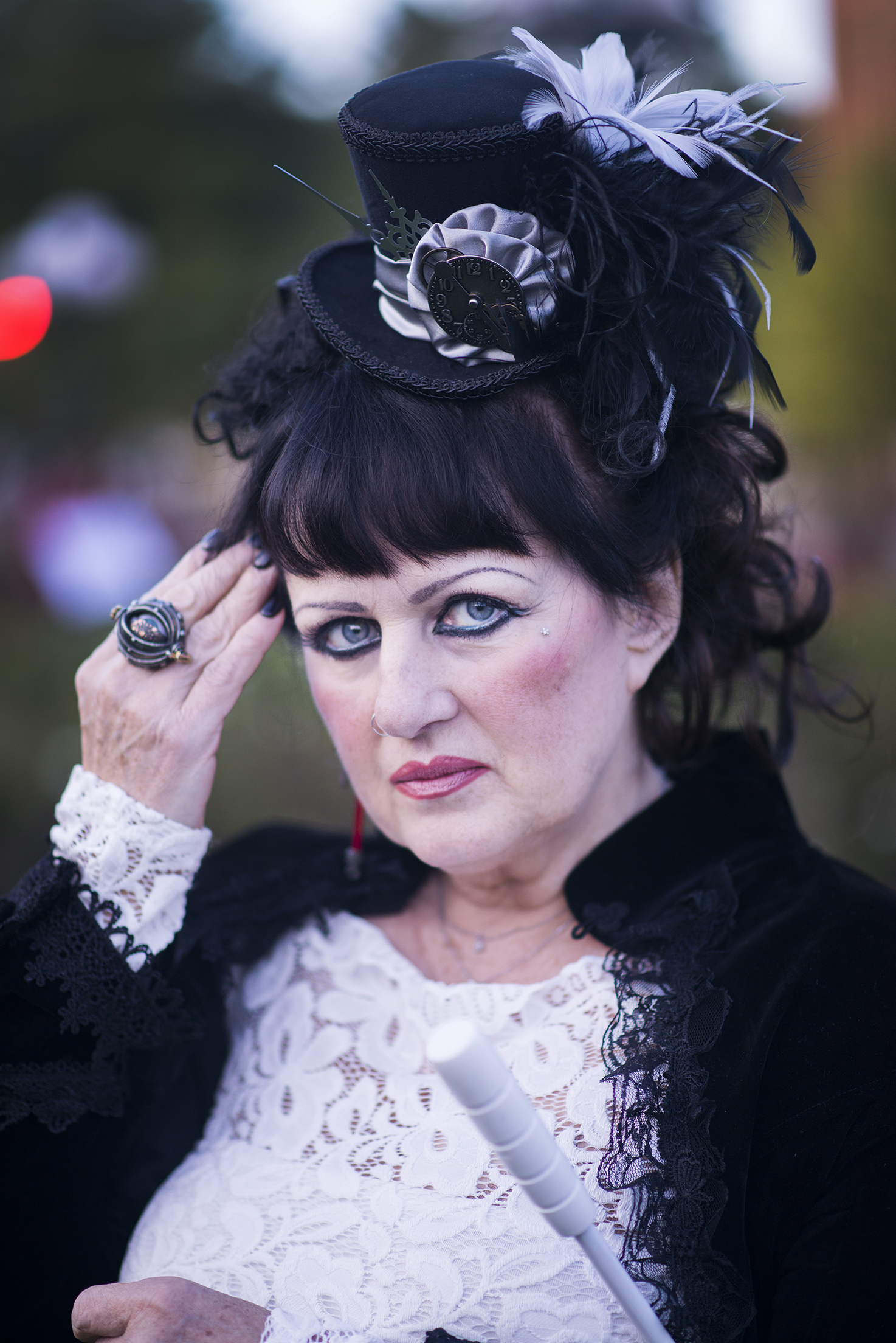 Penni AlZayer lives in a Victorian style home in McArthur, Ohio.  She fell in love with the steampunk style after finding images online.  Here, she poses for a portrait at Final Fridays on the Square in Nelsonville, Ohio on Friday, August 29, 2014.