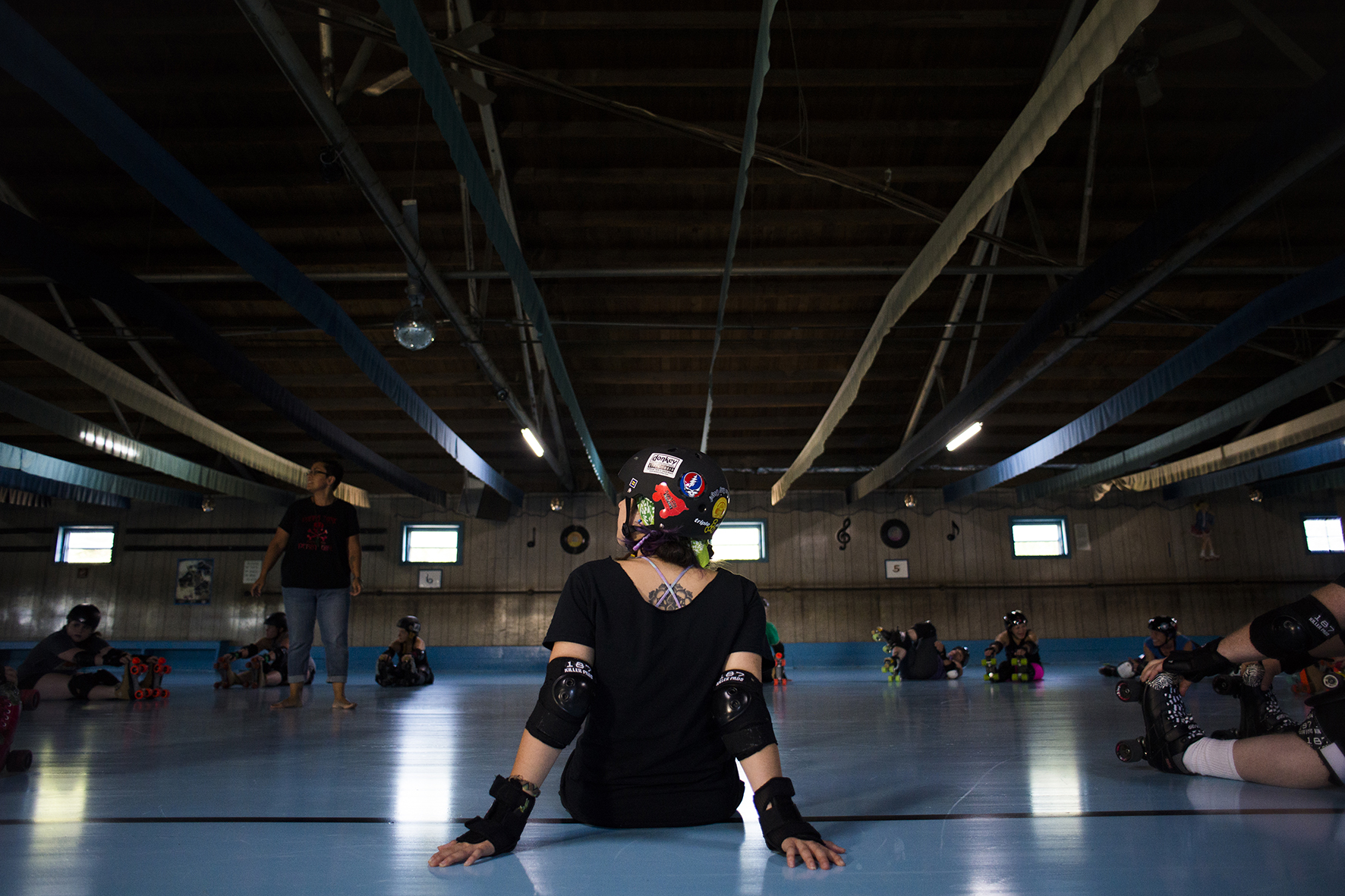 Abby Walter, known as Luna Killjoy, prepares to stretch at practice on Sunday, September 7, 2014 at Dow Roller Rink in Nelsonville, Ohio.