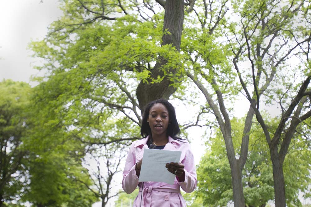 Alliyha Bowman, a senior at New School for Community Service, reads her right to life paper on Ambition before her peers at an end of the year picnic at Lincoln Park in Milwaukee, Wis. on Friday, June 5, 2015.