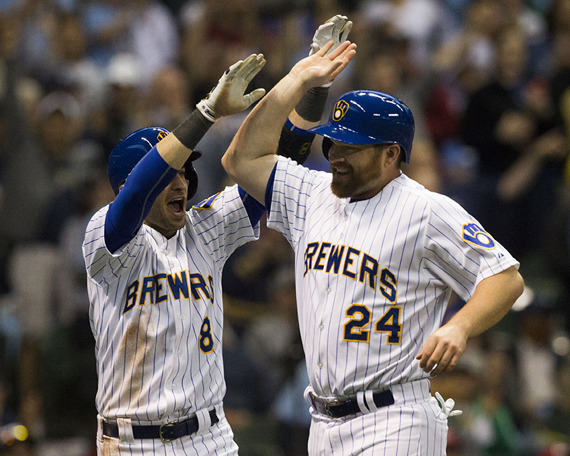 Outfielder Ryan Braun congratulates infielder, Adam Lind, on scoring the second point for the Brewers against the Washington Nationals during the bottom of the first inning on Friday, June 12, 2015.