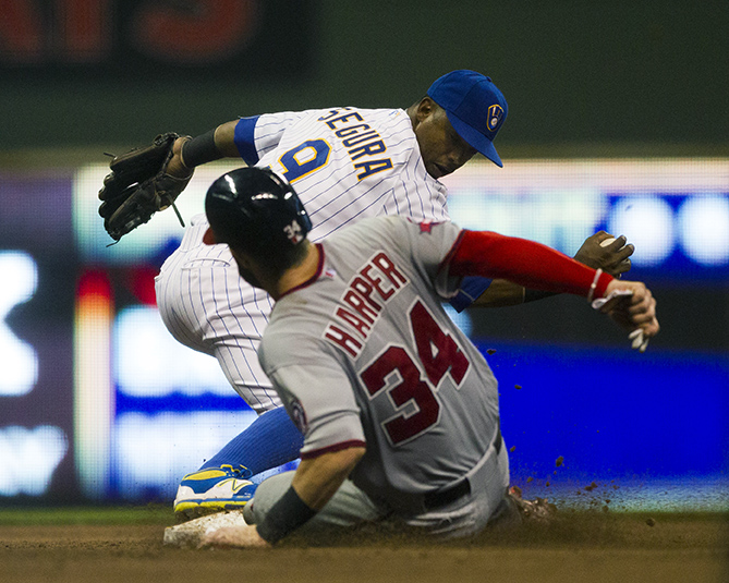 Washington Nationals' Bryce Harper slides into second as Milwaukee Brewers' second baseman, Jean Segura tags him out on Friday, June 12, 2015.