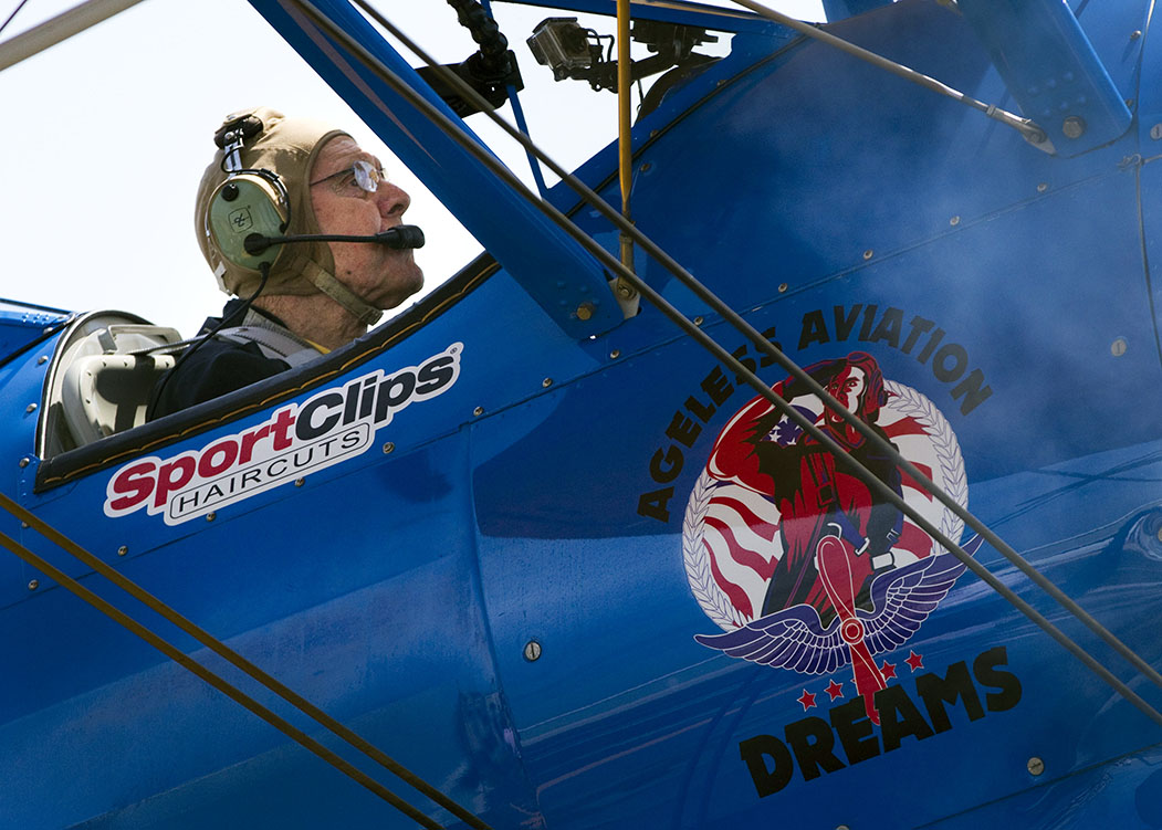 Dean Benzer, a 94-year-old Air Force Veteran from World War II, prepares for takeoff in a Boeing Stearman biplane on Wednesday, June 10, 2015. Benzer was one of many Veterans to take a dream flight with the Ageless Aviation Dreams Foundation.