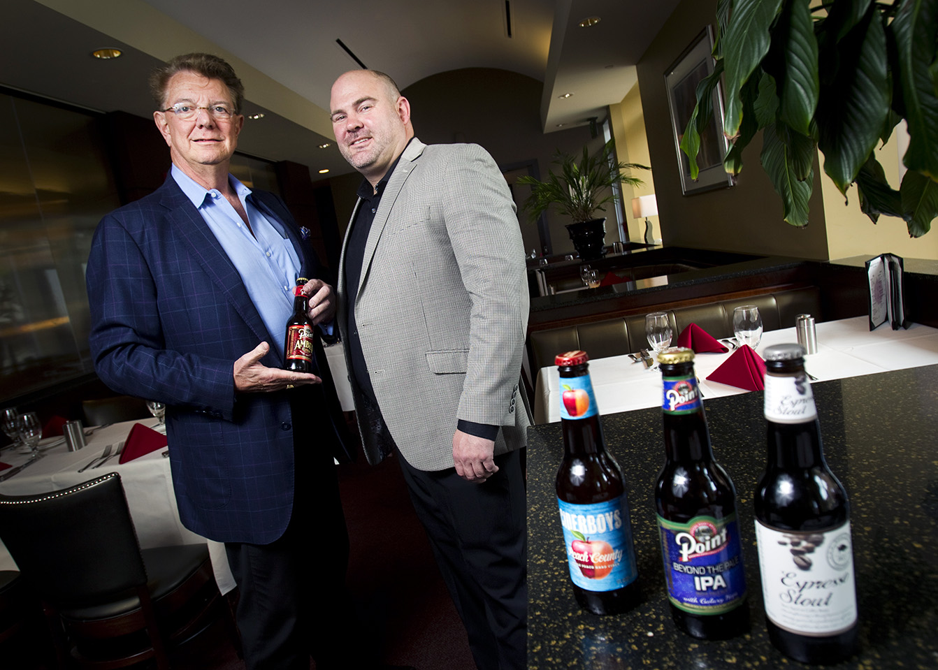 Jim Wiechmann (left), co-owner of Stevens Point Brewery and Brian Ward, owner of Ward's House of Prime,  and pose for a portrait inside Ward's House of Prime on Mason Street in Milwaukee, Wis. on Friday, June 12, 2015. Ward is opening a restaurant on the northwest side that has a licensing agreement with Point Brewery.