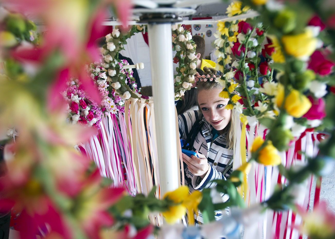 Abby Heinzen tries on traditional Polish flower wreaths on Saturday, June 13, 2015 at Polish Fest.  The wreaths are made from fake flowers, wire, and ribbon.