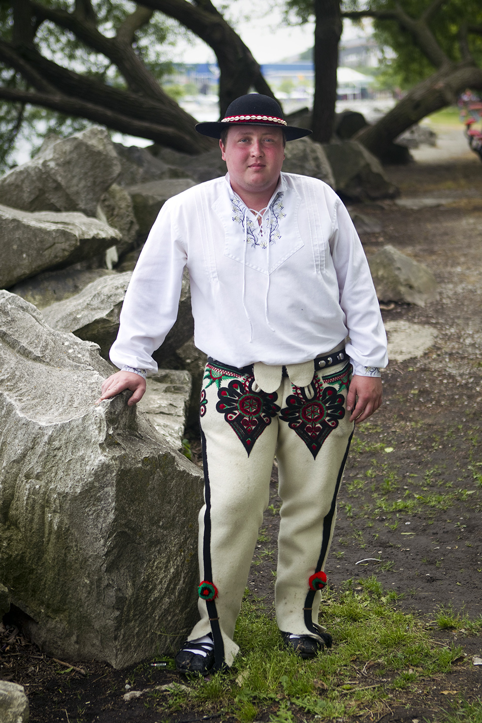 Michal Dzielski poses for a portrait in his traditional Polish outfit on Saturday, June 13, 2015 at Polish Fest. For men, a traditional outfit includes a white shirt and a hat with shells for decoration. The heart-shaped design on his trousers is known as parzenica.