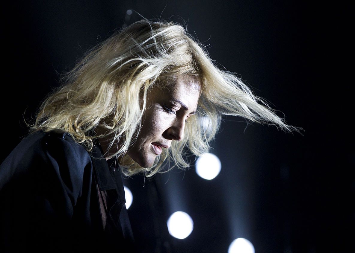 Emily Haines, lead vocalist for Metric, plays the synthesizer during the band's performance on Saturday, June 13, 2015.  Metric opened for Imagine Dragons.