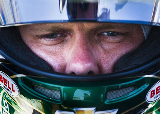 Ed Carpenter sits in his car before the Verizon Indycar Qualifiers on Sunday, July 12, 2015 during Indy Fest.