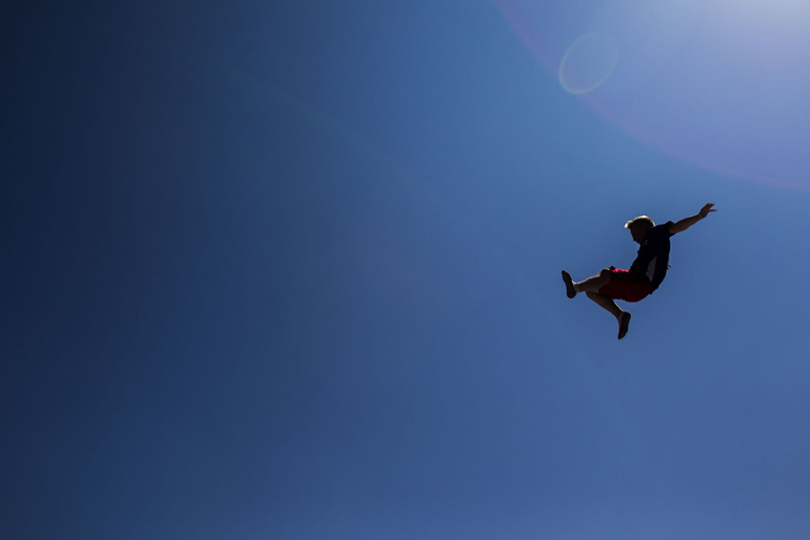 Nick Zehr, 11, leaps off of the Stunt Jump attraction in the Family Fun Zone during Indy Fest on Sunday, July 12, 2015.