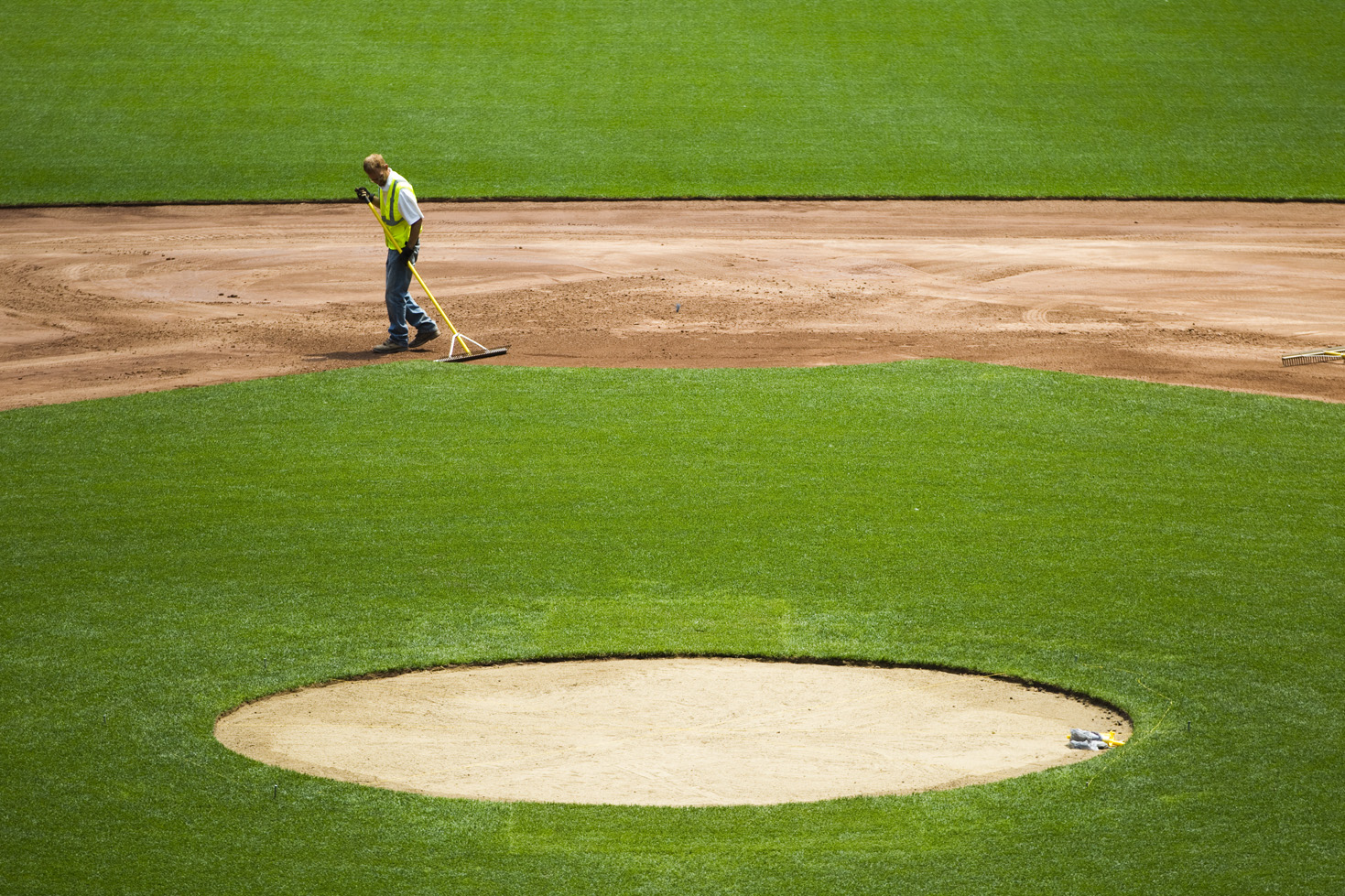The crew from Bush Turf, a subcontractor hired by Miller Park, begins to transform the baseball diamond into a soccer field on Friday, July 10, 2015.  The first step was to remove the clay surfaces and prepping the ground for the grass.