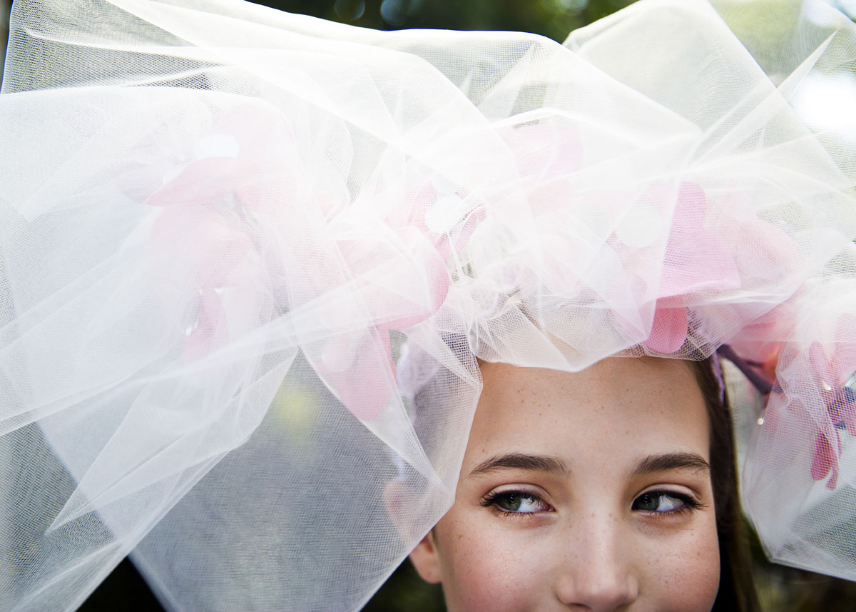 "Chicago resident Madeline Hills, 11, shows off her custom made hat that reflects the theme of the event during the ""Hats in the Garden"" fundraiser for the Naples Botanical Garden on Wednesday, November 9, 2016 in Naples. This year was the 13th Anniversary of Hats in the Garden and the theme was ""The Faces of Naples""."
