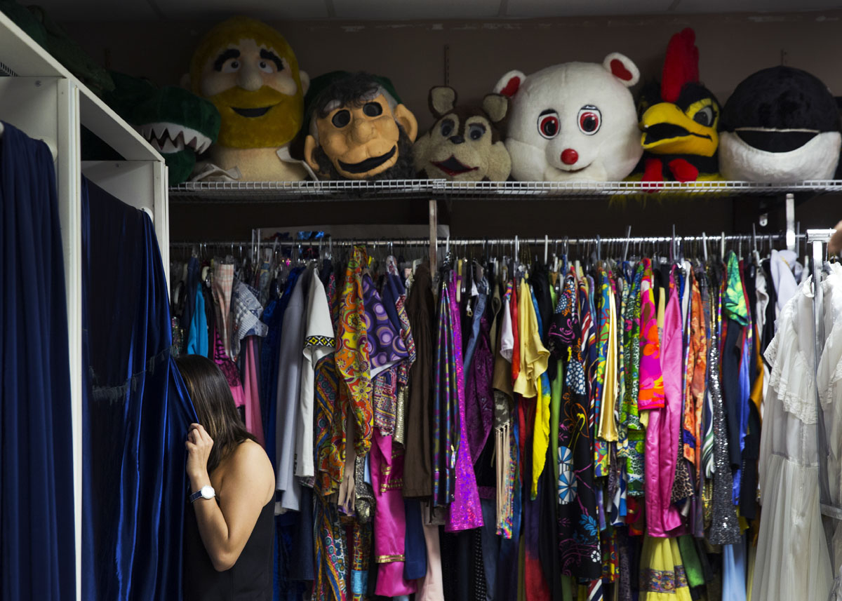 Ashley Singh looks inside the dressing room as her mother, Karen Singh, tries on a costume on Wednesday, October 19, 2016 at Masquerade & Balloons Galore in East Naples.
