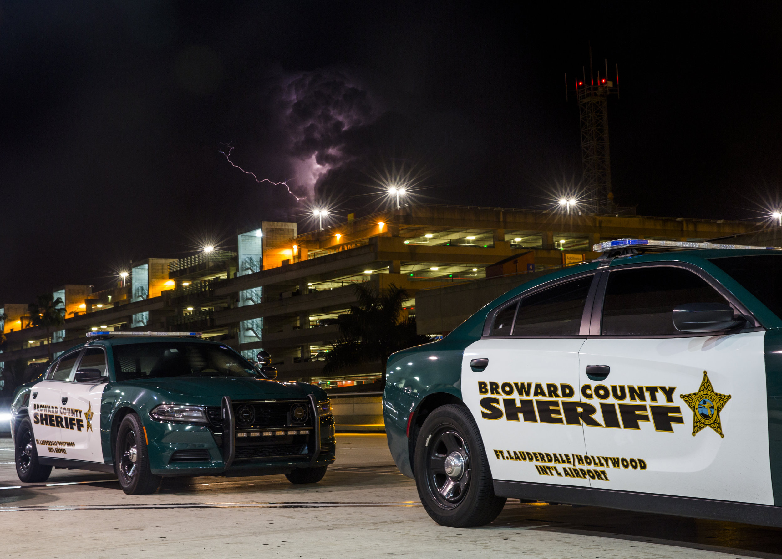 Broward County Sheriff vehicles park outside of terminal 2 at the Fort Lauderdale - Hollywood International Airport  in Fort Lauderdale, Fla. on Saturday, January 7, 2016.