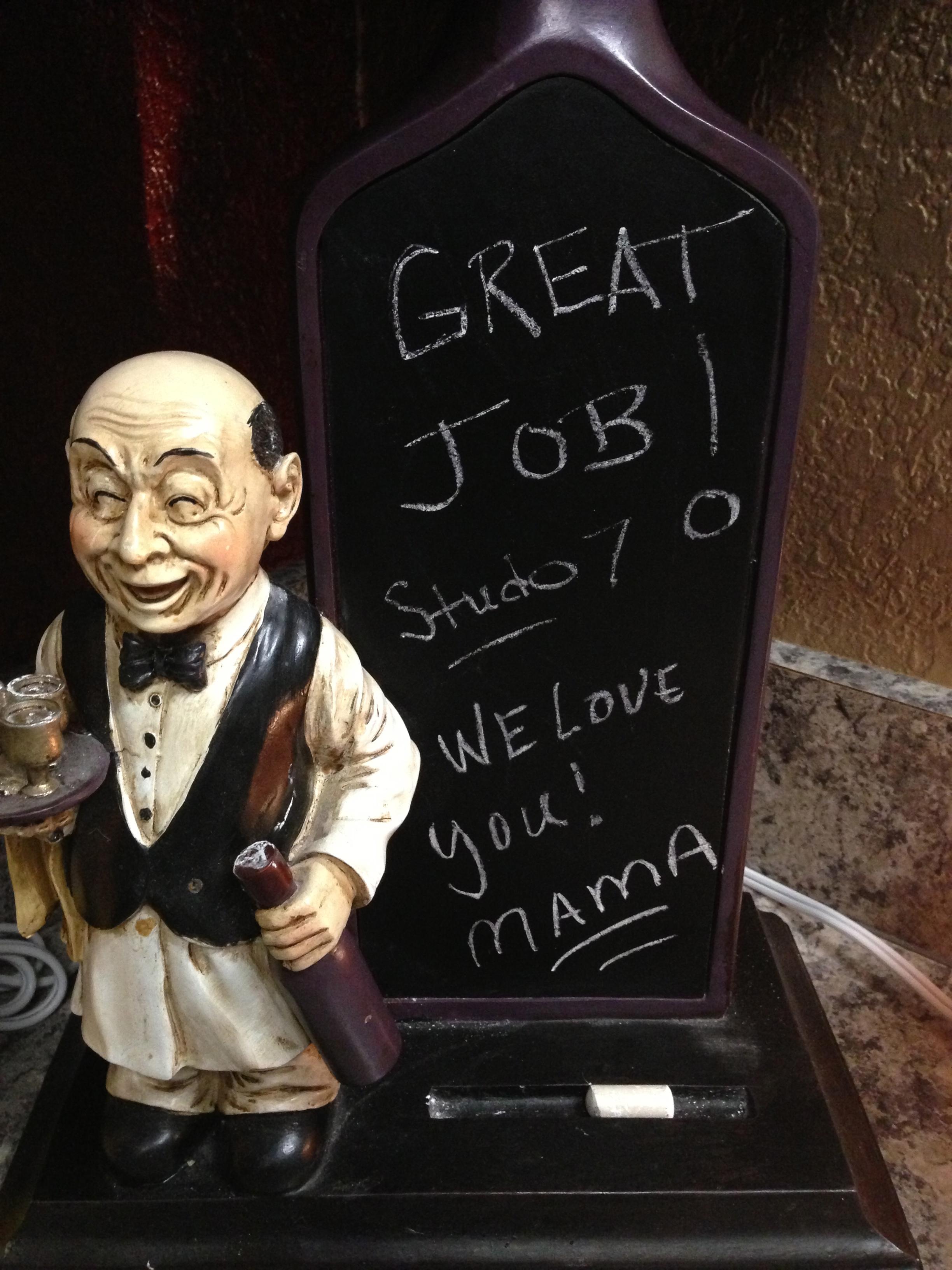 A chalkboard note from Brad & Emmy