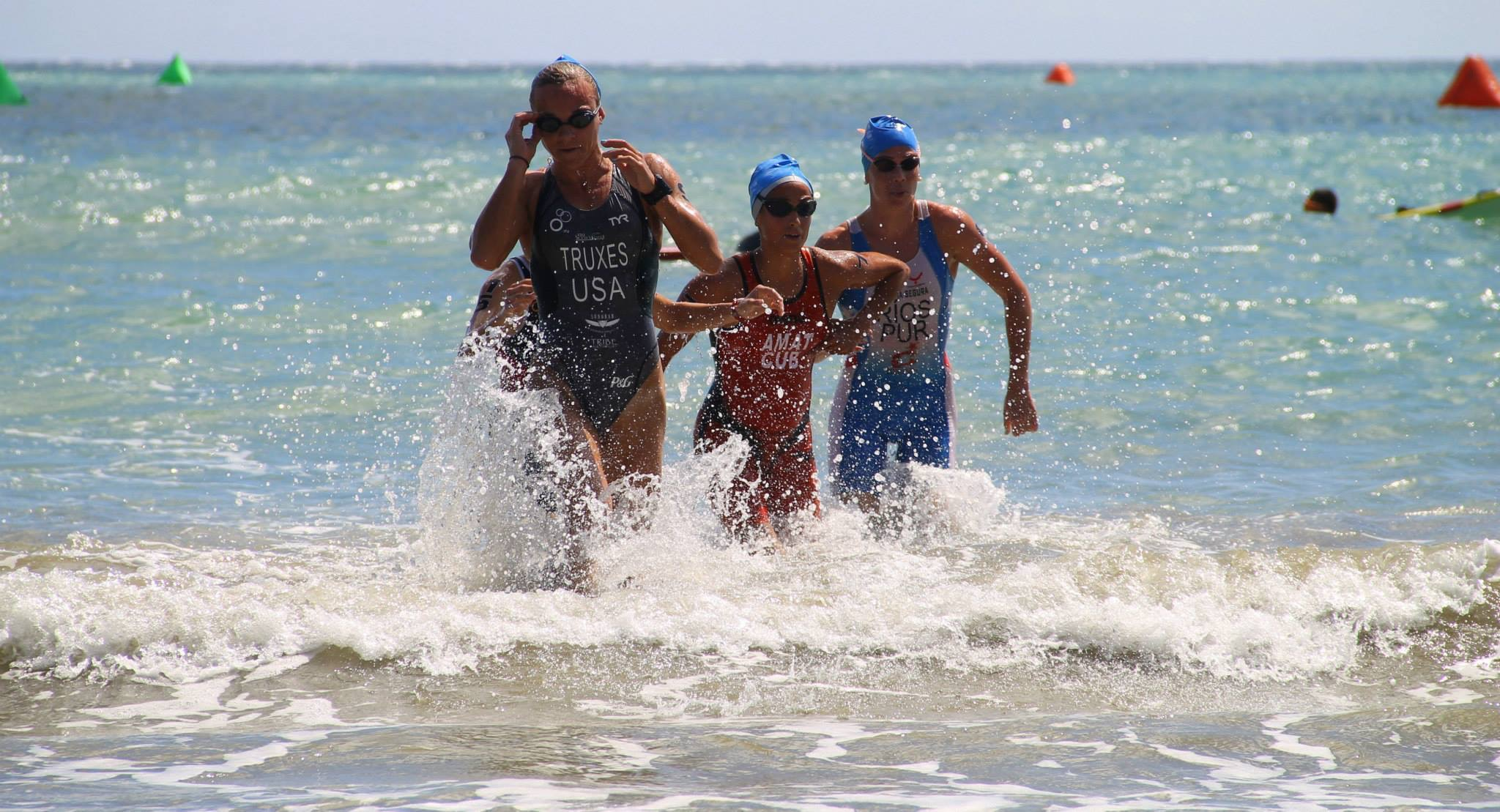 Coming out of the water in Puerto Rico with the girls that would become my bike pack.