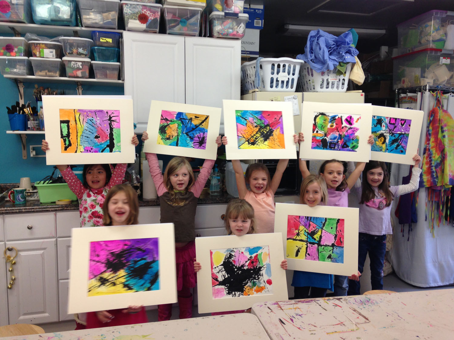kids-showing-off-artwork-at-art-by-tjm-studio-greensboro-img_0772.jpg