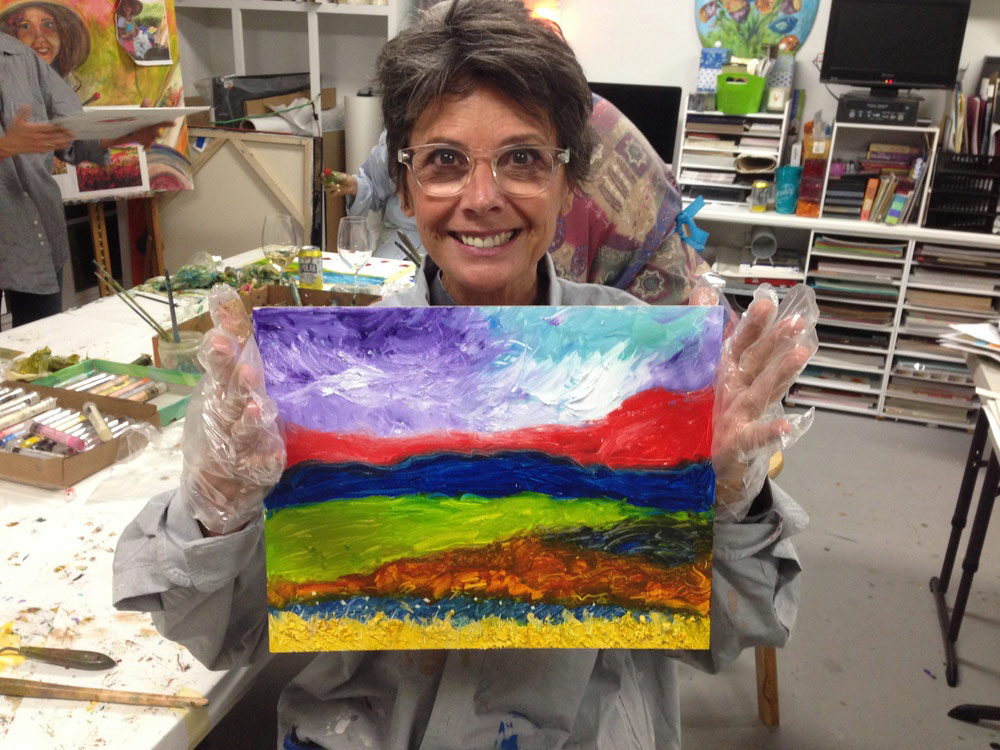 IMG_7033-adult-art-student-showing-off-painting-at-art-by-tjm-greensboro.jpg