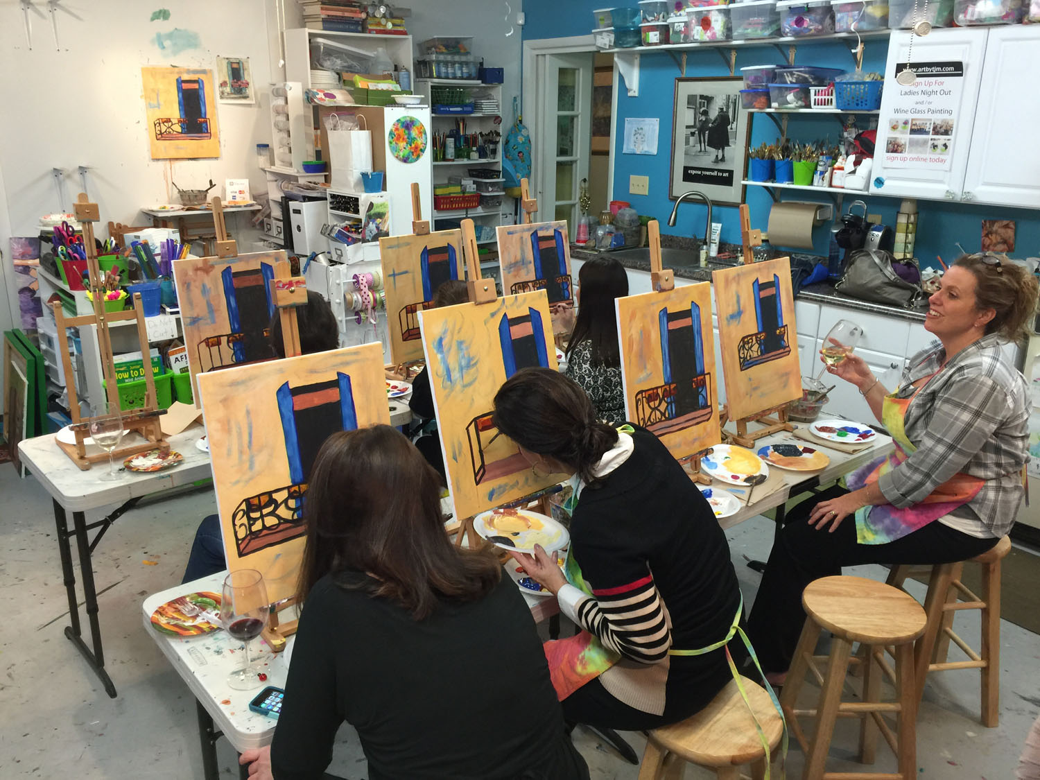 Group of ladies painting at Tracey J. Marshall's Greensboro studio during a recent canvas-painting Ladies' Night Out pARTy. Private parties available. Grab your friends and schedule an event for your group!