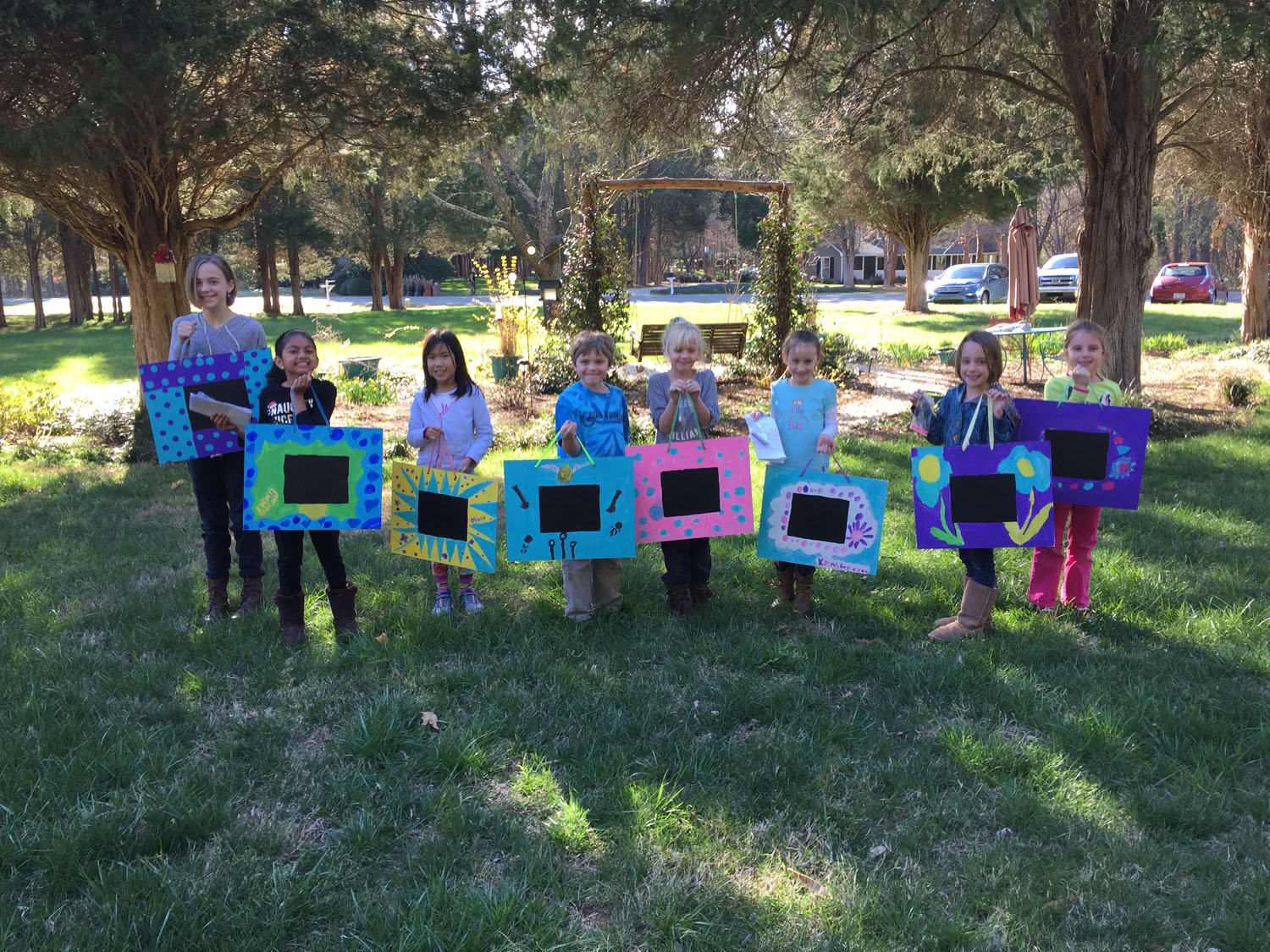 kids-showing-off-artwork-art-parties-classes-and-camps-in-greensboro-nc-with-artist-tracey-j-marshallIMG_9089.jpg