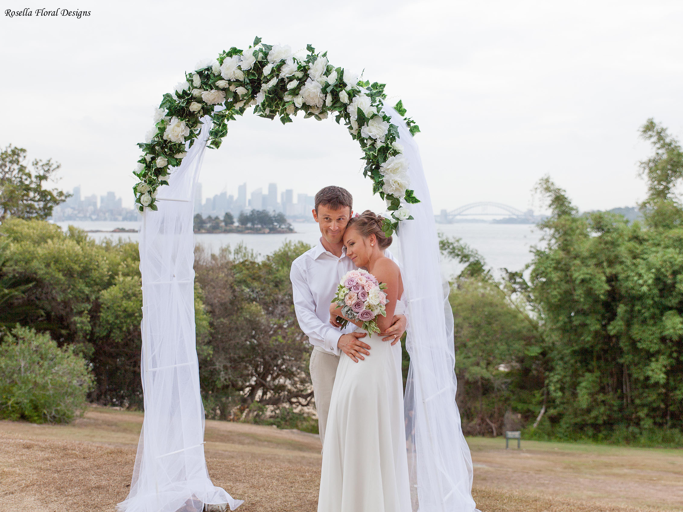 Floral arch for hire $150. Includes set up, silk flowers, tulle or white chiffon fabric  Dimensions: Arch Height: 2.25m ; Length: 1.2m; Depth: o.4m