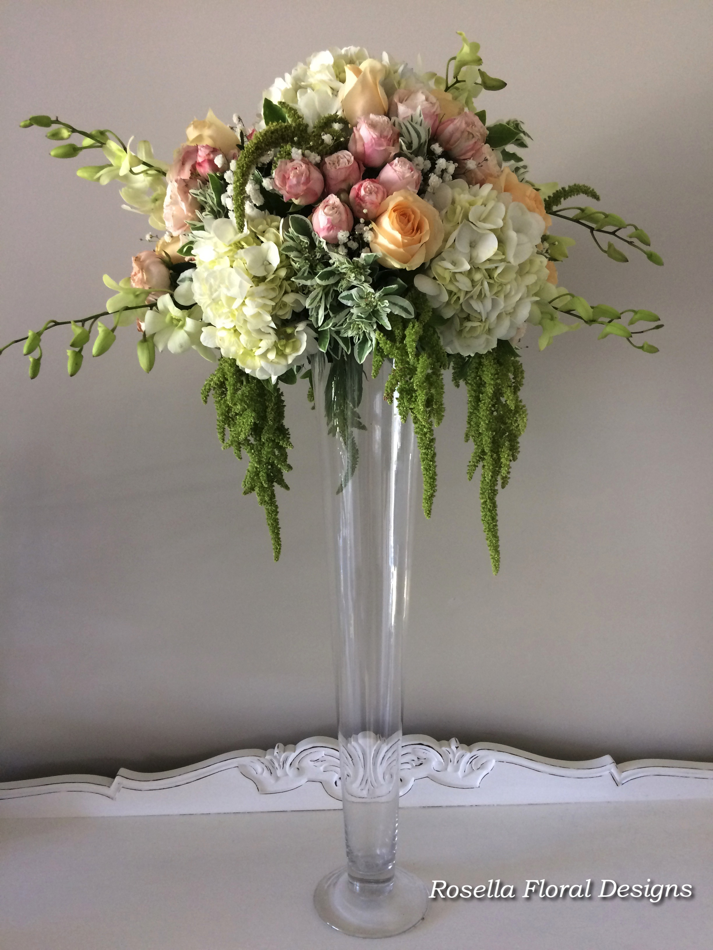 Tall floral table centerpiece pink peachy green whtie.jpg