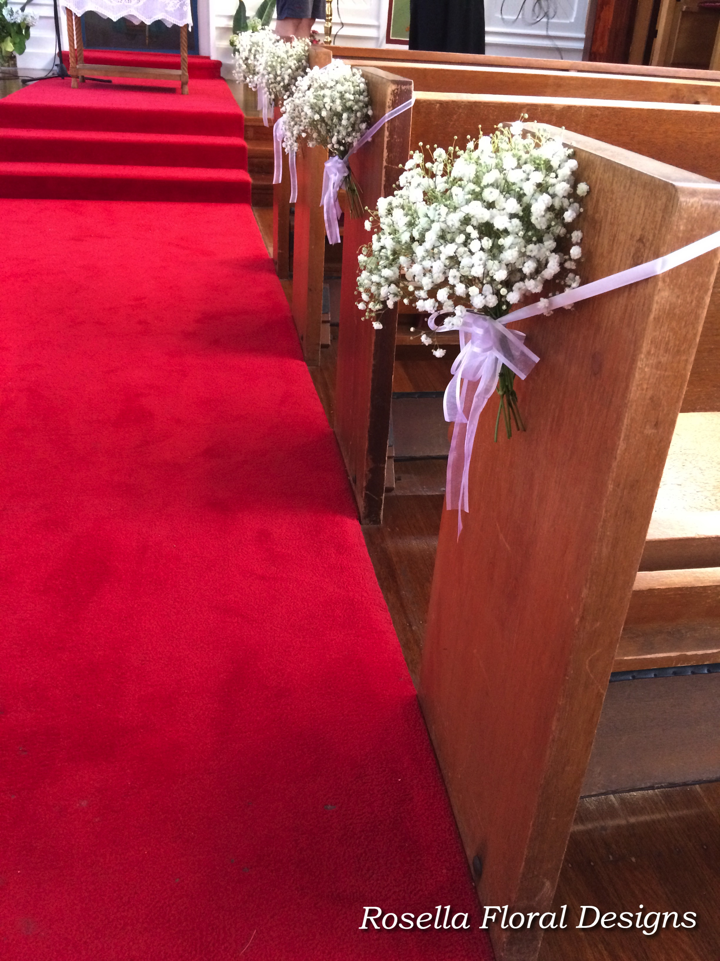 Baby's breath pew flowers.jpg