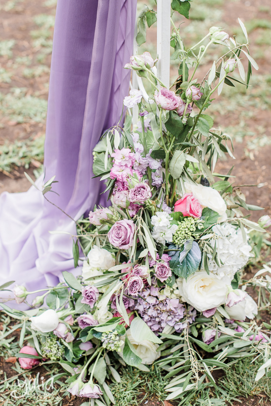 Arch flowers lilac draping.jpg
