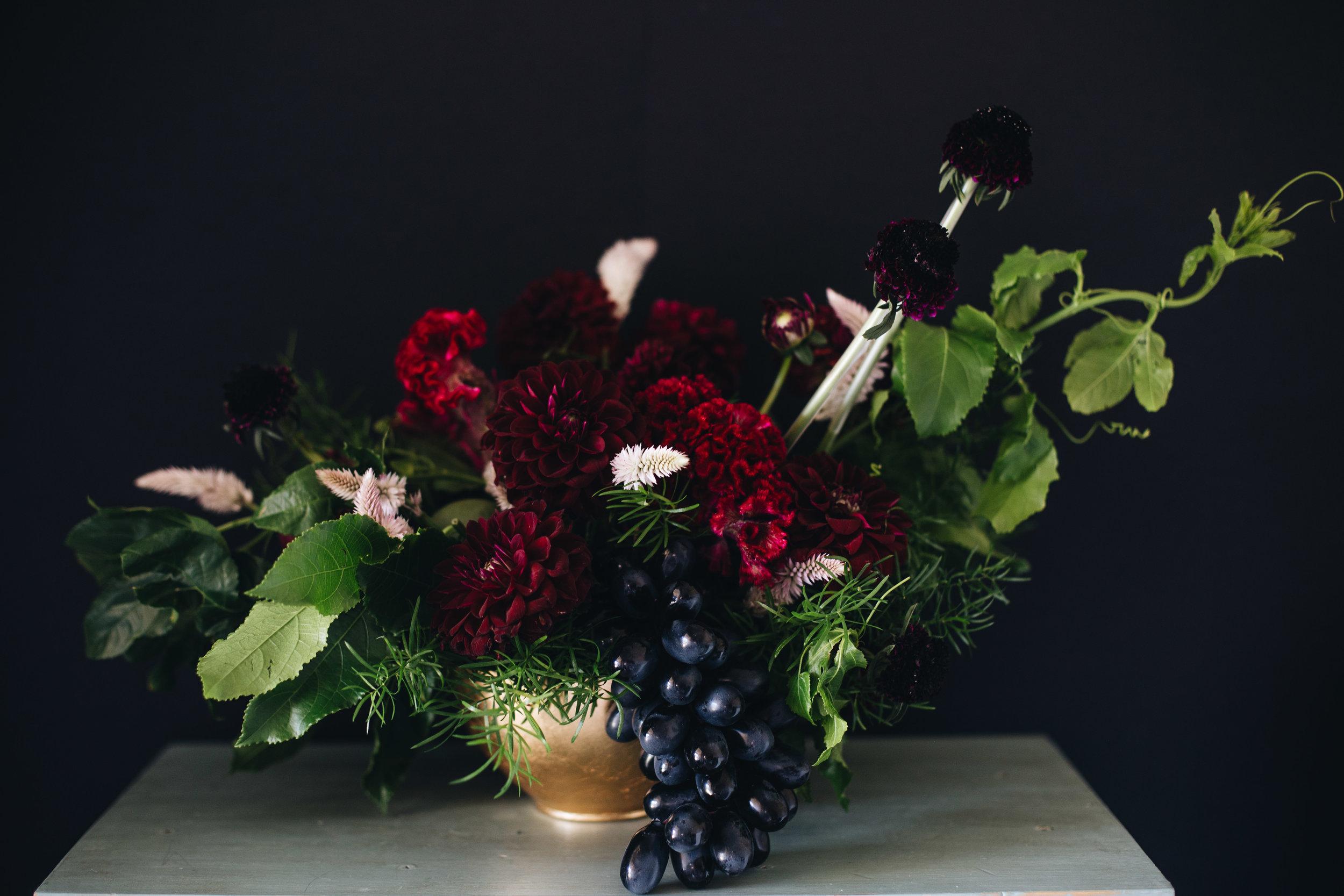 Floral arrangement in gold vase, burgundy maroon wedding.JPG