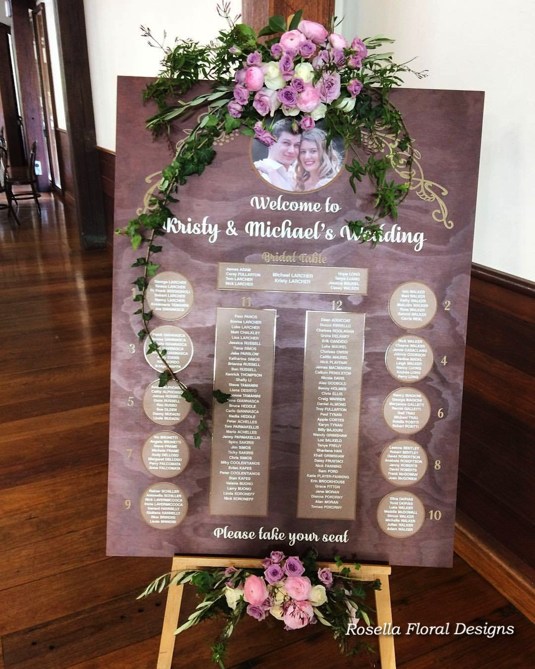 Wedding seating chart decorated with flowers.jpg