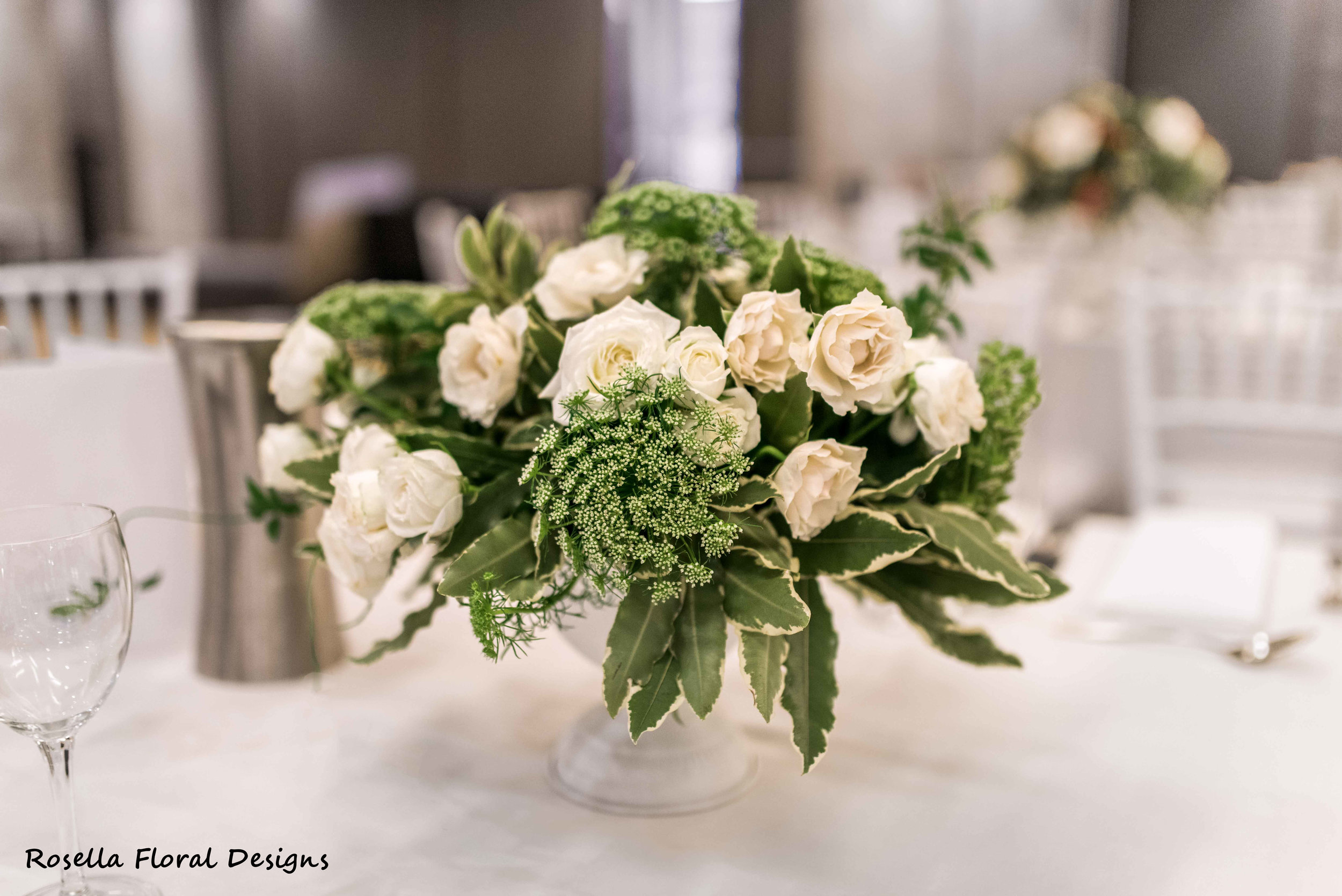 White & green blooms in a compote vase for wedding.JPG