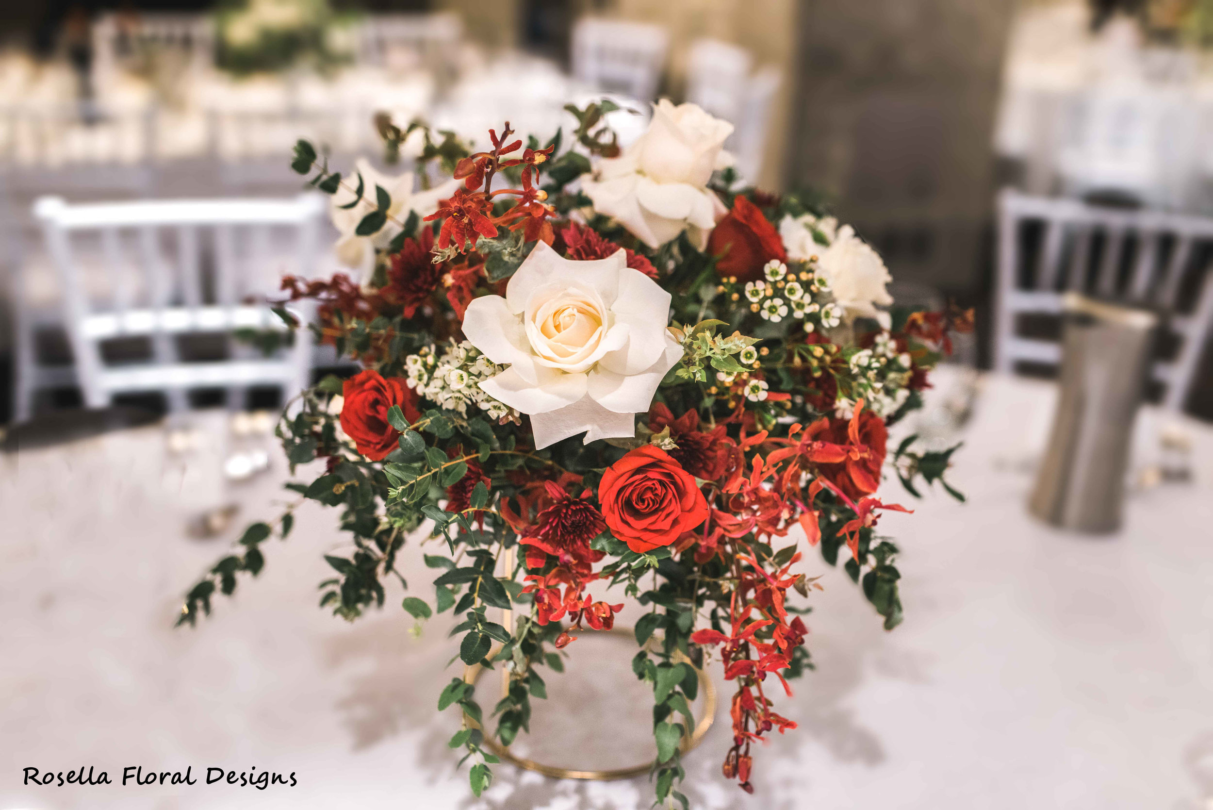 Red, white, green floral table centerpieces wedding.JPG