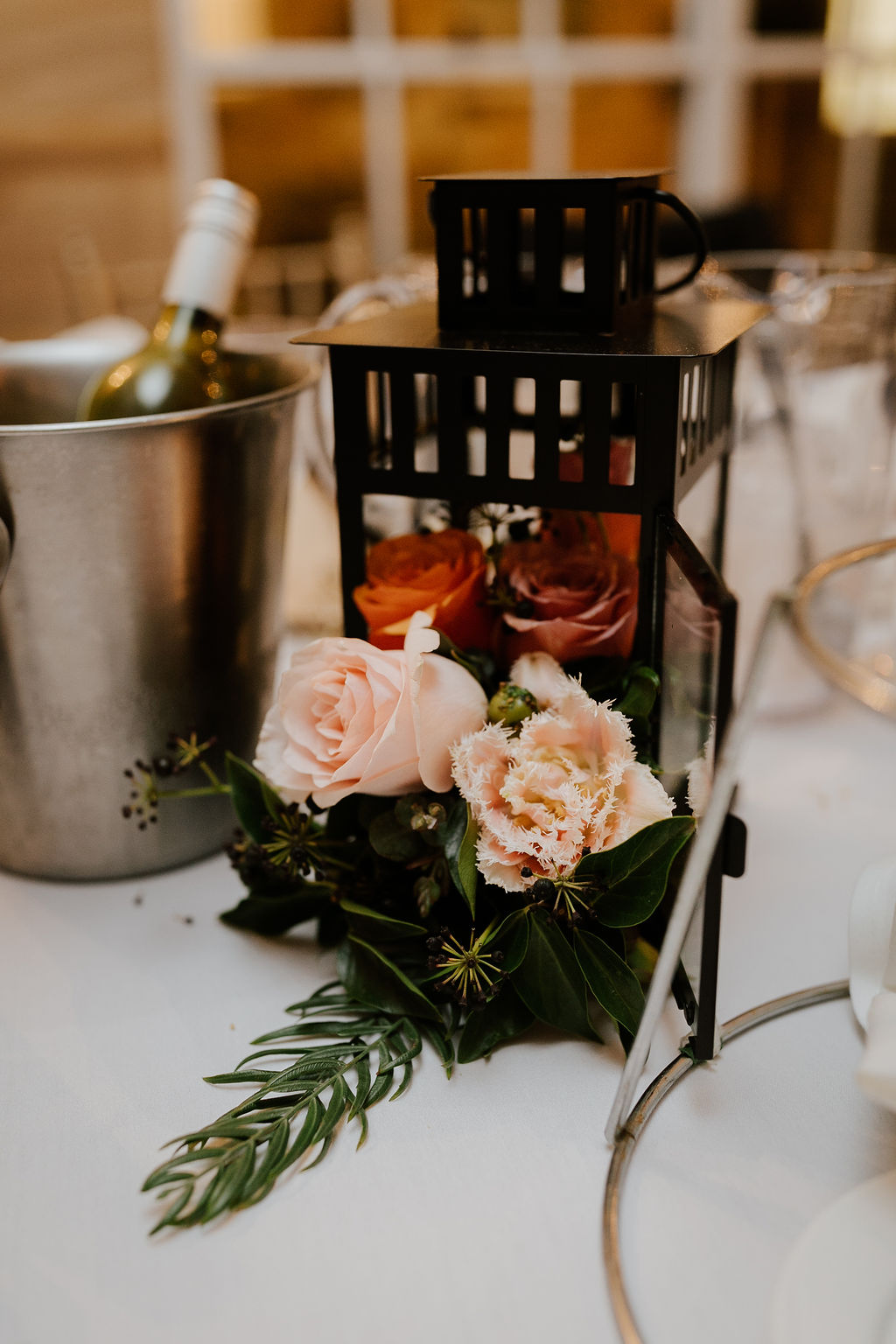 Floral lantern table centerpiece.jpg